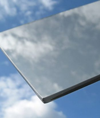 Solar energy reflective glass